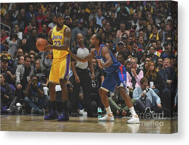 Nba Pro Basketball Canvas Print featuring the photograph Kawhi Leonard and Lebron James by Andrew D. Bernstein