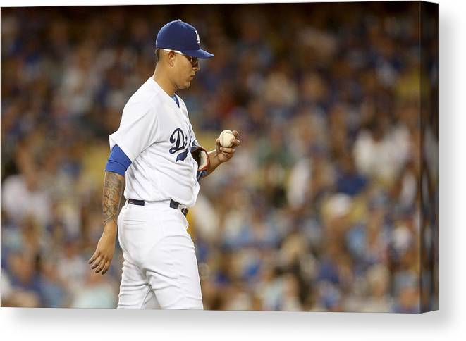 American League Baseball Canvas Print featuring the photograph Miami Marlins v Los Angeles Dodgers by Stephen Dunn