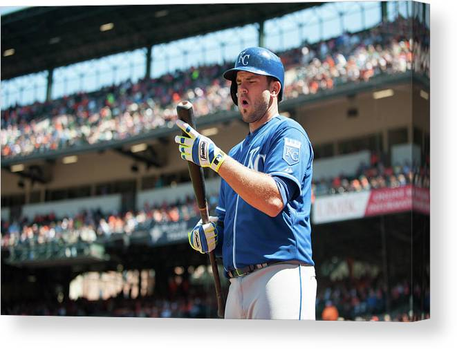 American League Baseball Canvas Print featuring the photograph Mike Moustakas by Rob Tringali