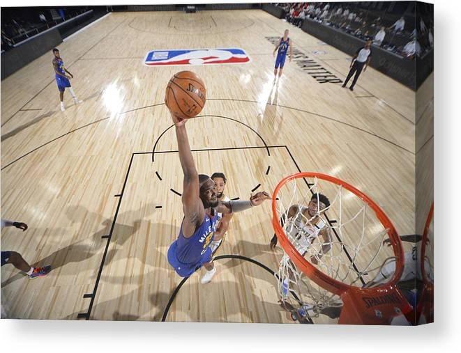 Nba Pro Basketball Canvas Print featuring the photograph Noah Vonleh by Garrett Ellwood