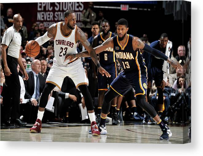 Nba Pro Basketball Canvas Print featuring the photograph Paul George and Lebron James by David Liam Kyle