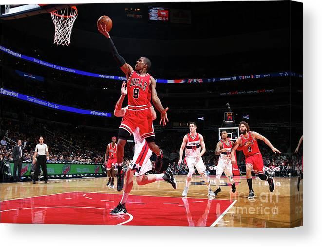 Nba Pro Basketball Canvas Print featuring the photograph Rajon Rondo by Ned Dishman