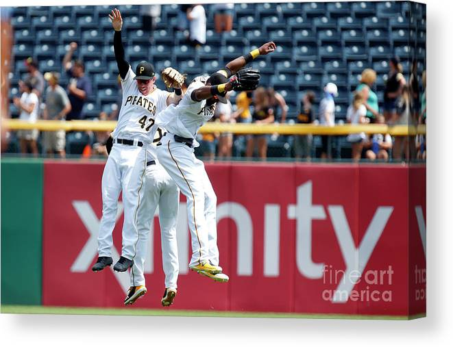 People Canvas Print featuring the photograph Starling Marte and Gregory Polanco by Justin K. Aller