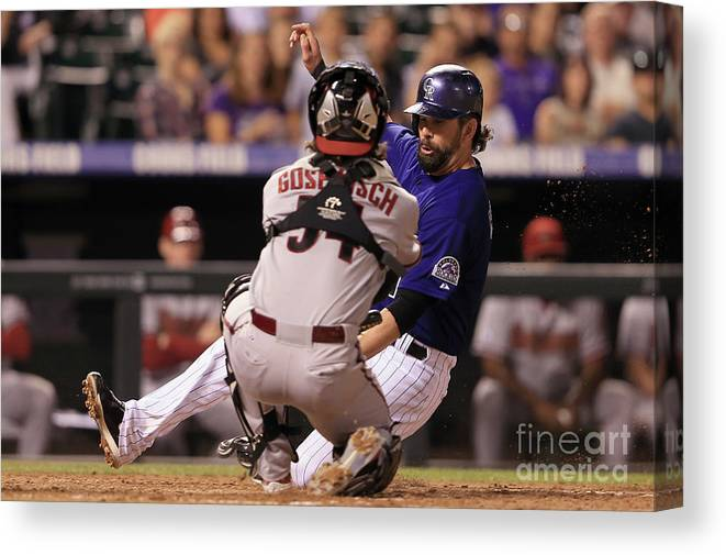Baseball Catcher Canvas Print featuring the photograph Todd Helton and Jordan Pacheco by Doug Pensinger