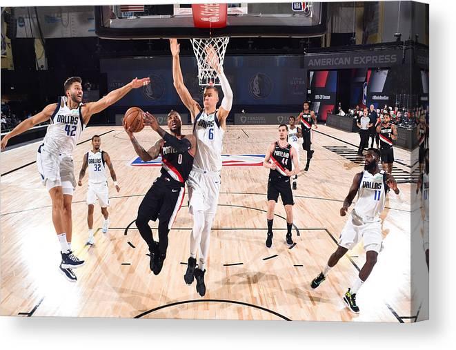 Nba Pro Basketball Canvas Print featuring the photograph Damian Lillard by Garrett Ellwood