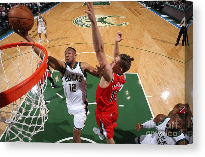 Nba Pro Basketball Canvas Print featuring the photograph Jabari Parker by Gary Dineen