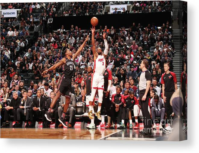 Nba Pro Basketball Canvas Print featuring the photograph Dwyane Wade by Issac Baldizon