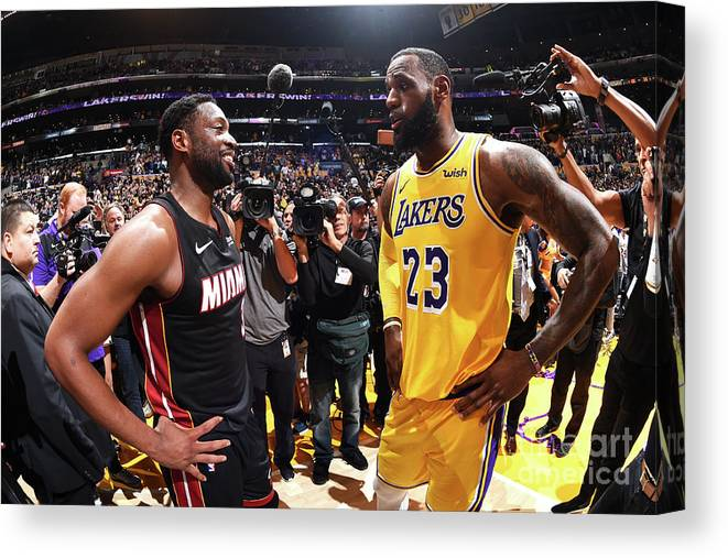 Nba Pro Basketball Canvas Print featuring the photograph Dwyane Wade and Lebron James by Andrew D. Bernstein