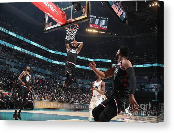 Nba Pro Basketball Canvas Print featuring the photograph Dwyane Wade and Lebron James by Nathaniel S. Butler