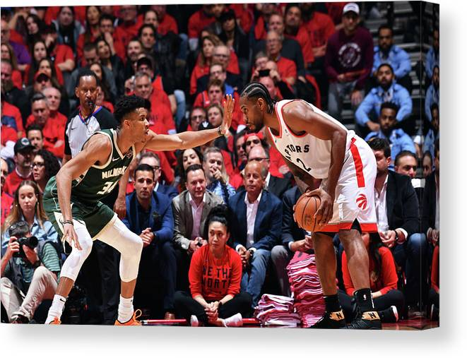 Playoffs Canvas Print featuring the photograph Kawhi Leonard and Giannis Antetokounmpo by Jesse D. Garrabrant