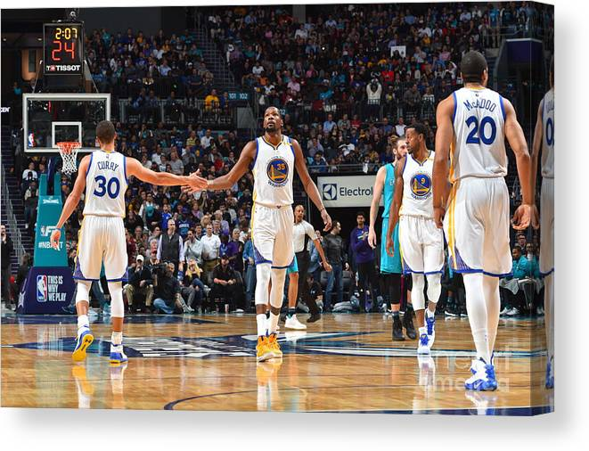 Nba Pro Basketball Canvas Print featuring the photograph Stephen Curry and Kevin Durant by Jesse D. Garrabrant
