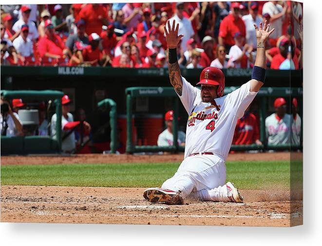St. Louis Cardinals Canvas Print featuring the photograph Yadier Molina by Dilip Vishwanat