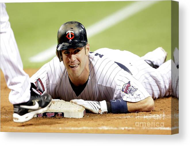 Hubert H. Humphrey Metrodome Canvas Print featuring the photograph Joe Mauer by Jamie Squire
