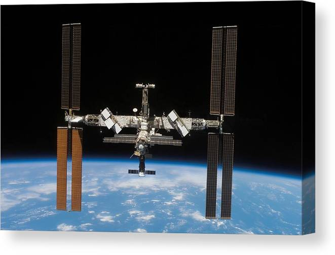 Curve Canvas Print featuring the photograph International Space Station by Stocktrek Images