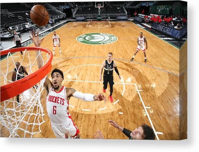 Nba Pro Basketball Canvas Print featuring the photograph Houston Rockets v Milwaukee Bucks by Gary Dineen