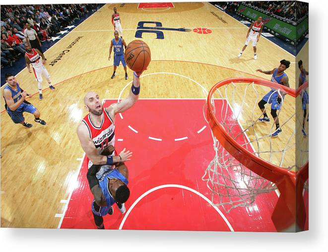 Nba Pro Basketball Canvas Print featuring the photograph Marcin Gortat by Ned Dishman