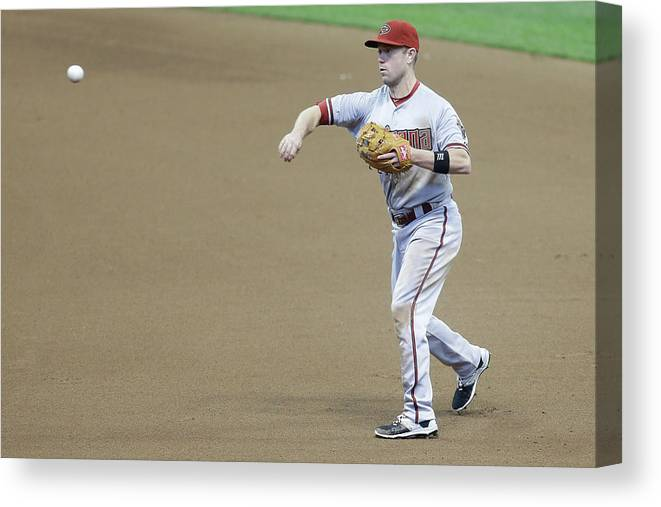 People Canvas Print featuring the photograph Adam Lind and Chris Owings by Mike Mcginnis
