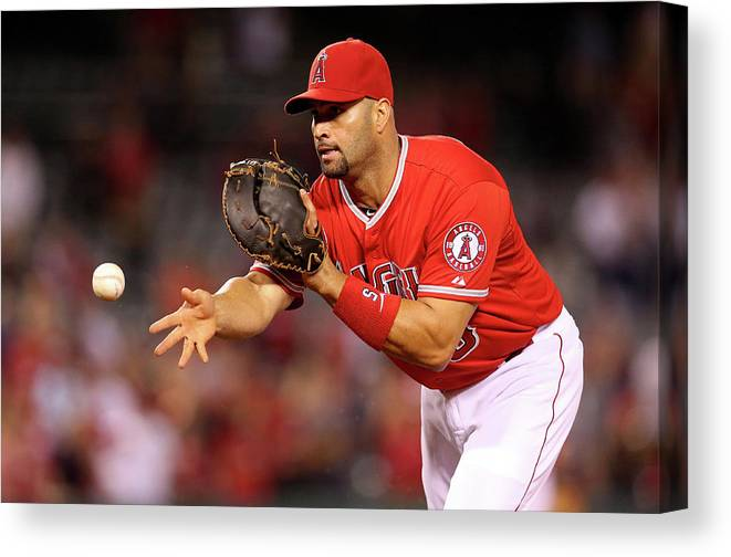 American League Baseball Canvas Print featuring the photograph Albert Pujols, Nick Franklin, and Cam Bedrosian by Stephen Dunn