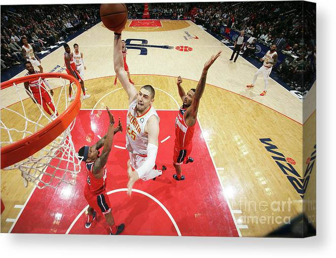 Nba Pro Basketball Canvas Print featuring the photograph Alex Len by Ned Dishman