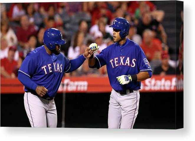 American League Baseball Canvas Print featuring the photograph Alex Rios and Prince Fielder by Stephen Dunn