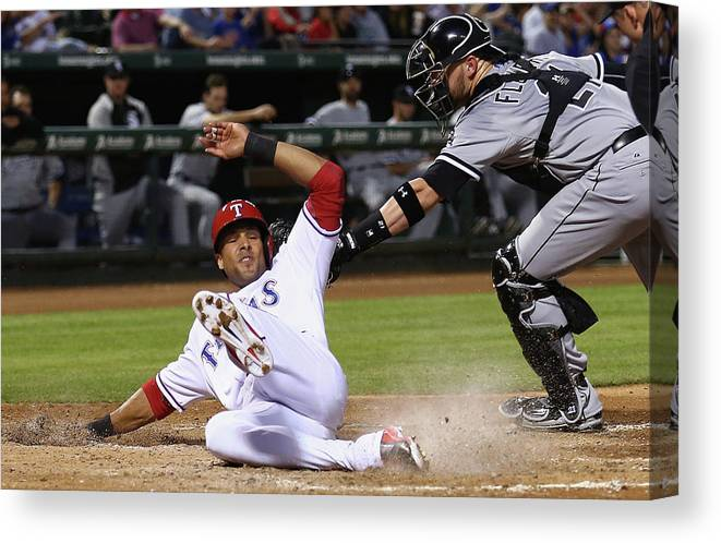 American League Baseball Canvas Print featuring the photograph Alex Rios and Tyler Flowers by Tom Pennington