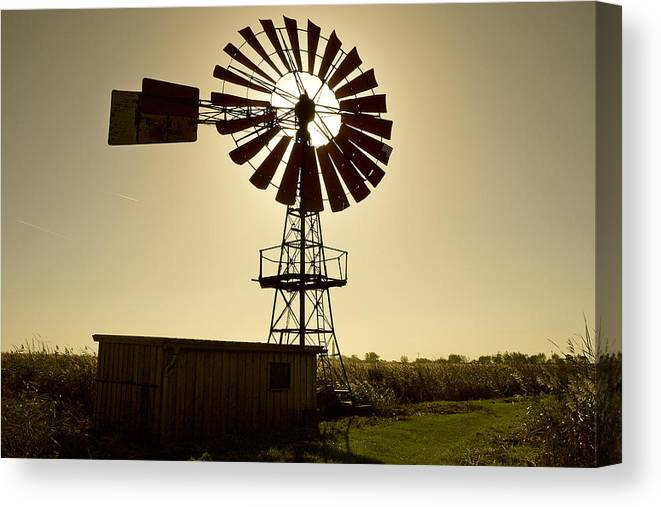 Outdoors Canvas Print featuring the photograph American-style windmill in backlight by Bernd Schunack