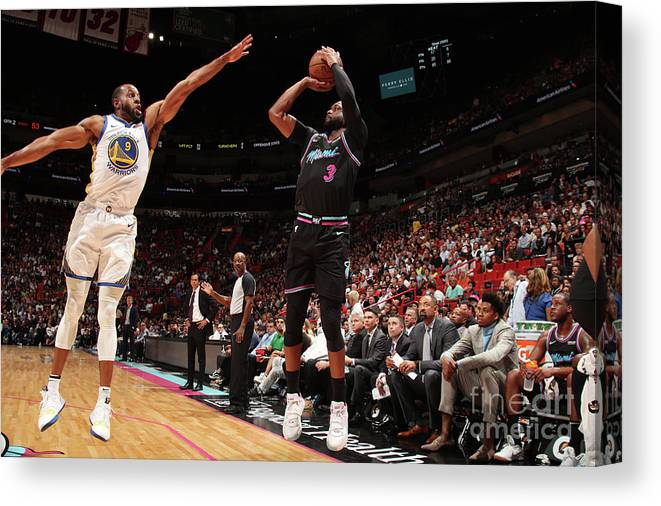 Nba Pro Basketball Canvas Print featuring the photograph Andre Iguodala and Dwyane Wade by Issac Baldizon