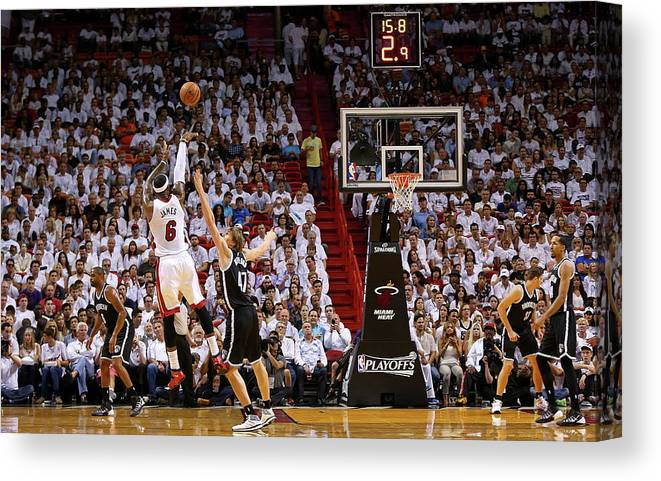 Playoffs Canvas Print featuring the photograph Andrei Kirilenko and Lebron James by Mike Ehrmann