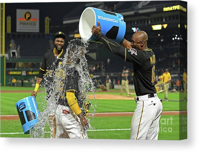 Three Quarter Length Canvas Print featuring the photograph Andrew Mccutchen, Starling Marte, and Gregory Polanco by Justin Berl