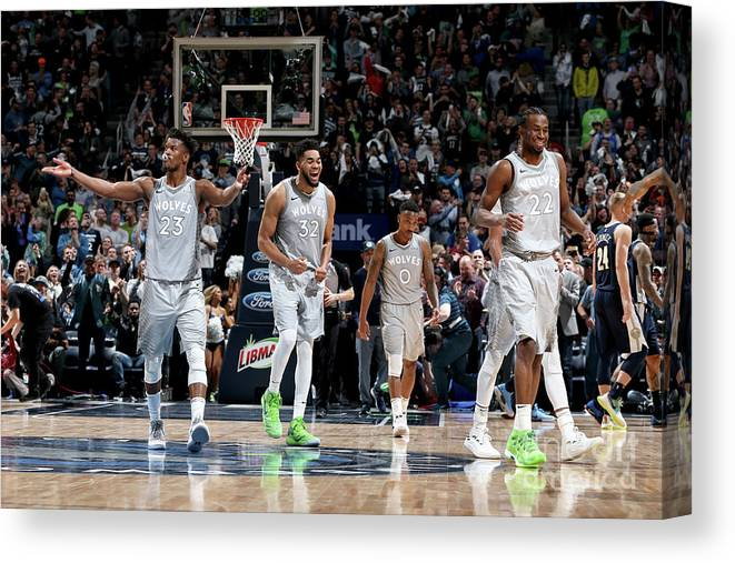 Nba Pro Basketball Canvas Print featuring the photograph Andrew Wiggins and Jeff Teague by David Sherman