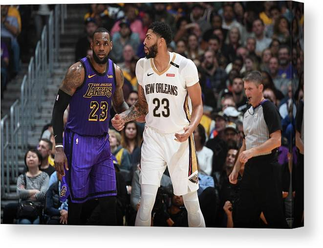 Nba Pro Basketball Canvas Print featuring the photograph Anthony Davis and Lebron James by Andrew D. Bernstein