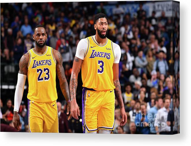 Nba Pro Basketball Canvas Print featuring the photograph Anthony Davis and Lebron James by Jesse D. Garrabrant