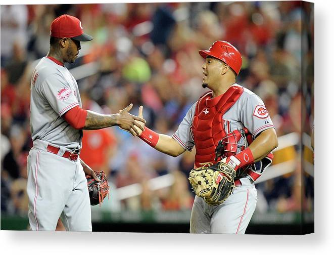 Three Quarter Length Canvas Print featuring the photograph Aroldis Chapman and Brayan Pena by Greg Fiume