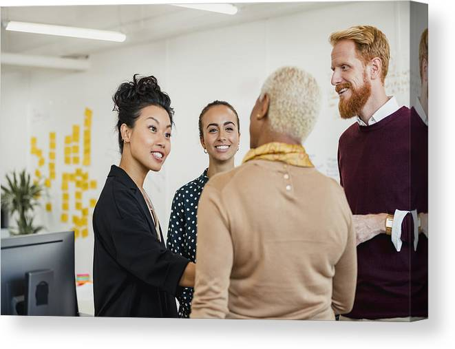 Working Canvas Print featuring the photograph Brainstorming as a Group by SolStock