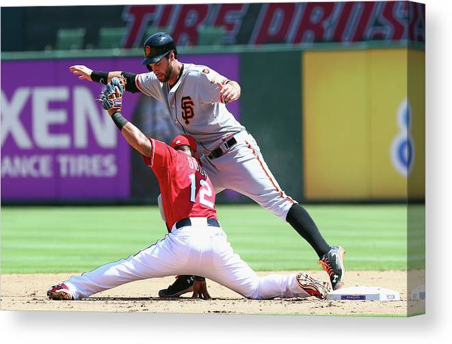 People Canvas Print featuring the photograph Brandon Belt and Rougned Odor by Ronald Martinez