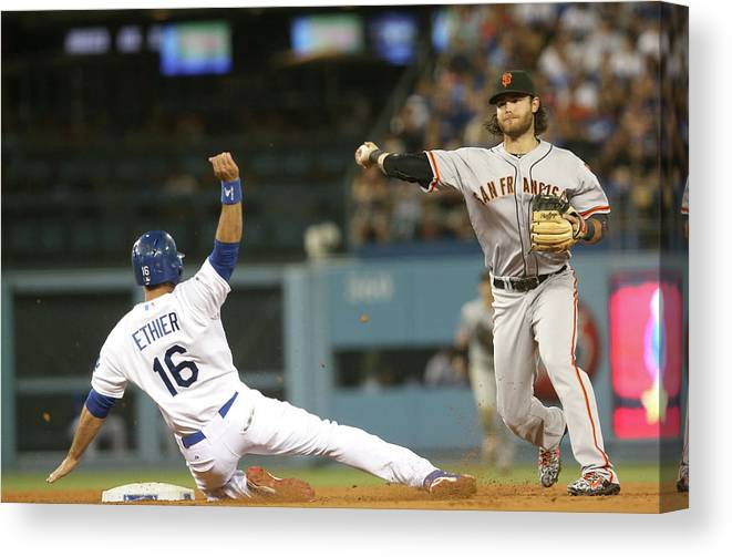 Double Play Canvas Print featuring the photograph Brandon Crawford and Andre Ethier by Stephen Dunn