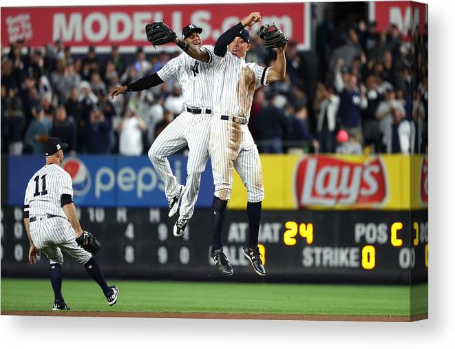 Playoffs Canvas Print featuring the photograph Brett Gardner, Aaron Judge, and Aaron Hicks by Al Bello