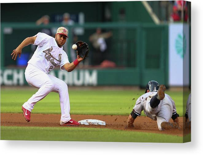 St. Louis Cardinals Canvas Print featuring the photograph Brett Gardner and Jhonny Peralta by Dilip Vishwanat
