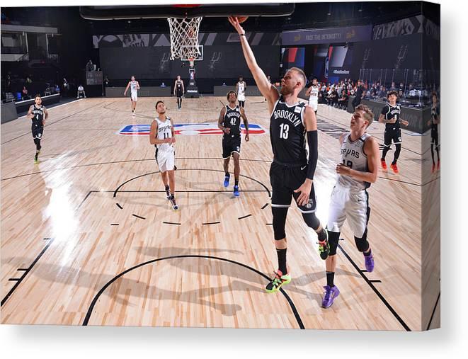 Nba Pro Basketball Canvas Print featuring the photograph Brooklyn Nets v San Antonio Spurs by Jesse D. Garrabrant