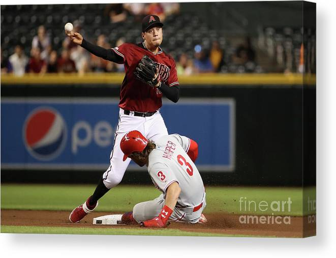 American League Baseball Canvas Print featuring the photograph Bryce Harper And Wilmer Flores by Christian Petersen