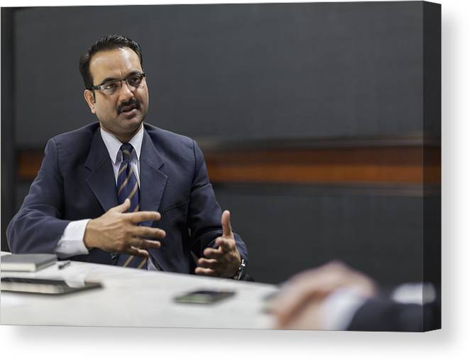 Corporate Business Canvas Print featuring the photograph Businessman explaining idea in office meeting by Shannon Fagan