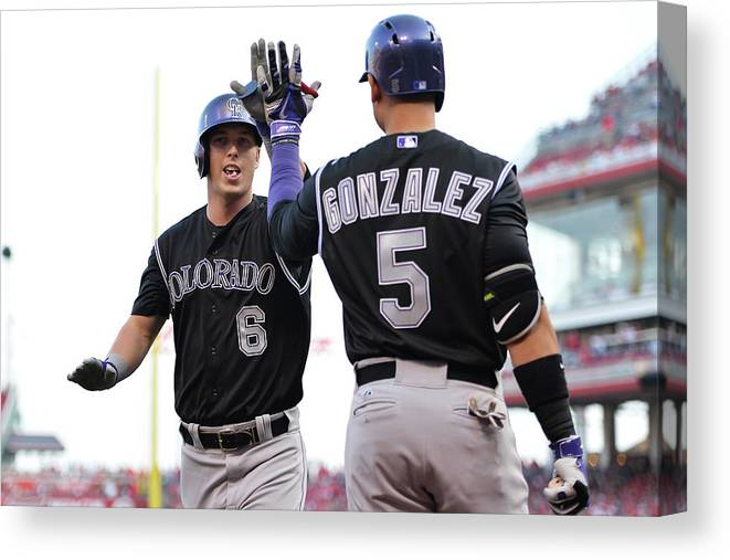 Great American Ball Park Canvas Print featuring the photograph Carlos Gonzalez and Corey Dickerson by Jamie Sabau