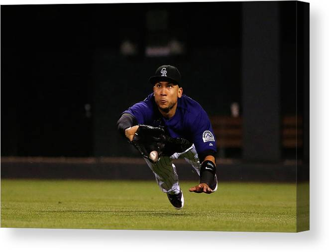 People Canvas Print featuring the photograph Carlos Gonzalez and Pete Kozma by Doug Pensinger