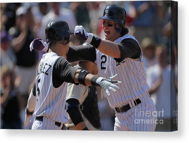 Scoring Canvas Print featuring the photograph Carlos Gonzalez and Troy Tulowitzki by Doug Pensinger