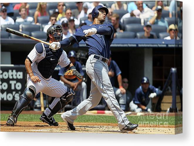 Following Canvas Print featuring the photograph Carlos Pena by Jim Mcisaac