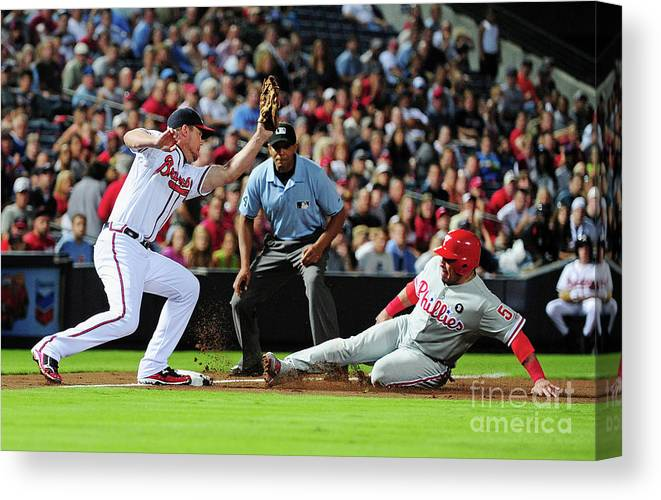 Atlanta Canvas Print featuring the photograph Carlos Ruiz and Chipper Jones by Scott Cunningham