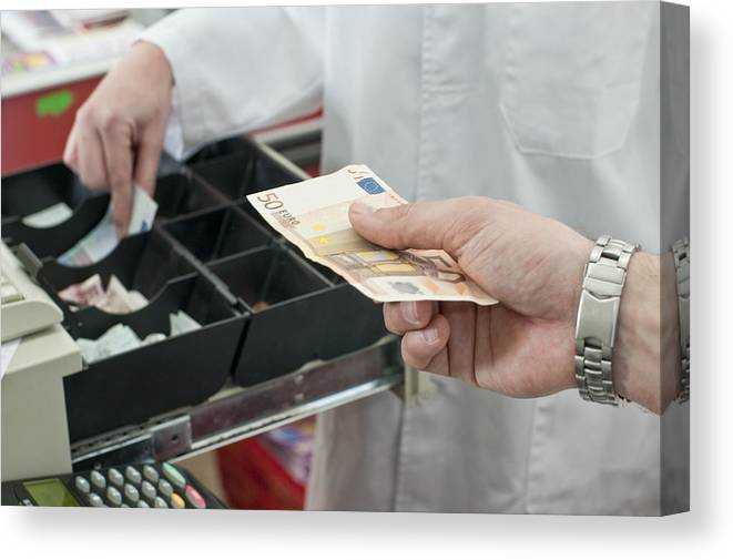 Young Men Canvas Print featuring the photograph Cash In Hand Of Customer Paying In Supermarket by Chris Sattlberger