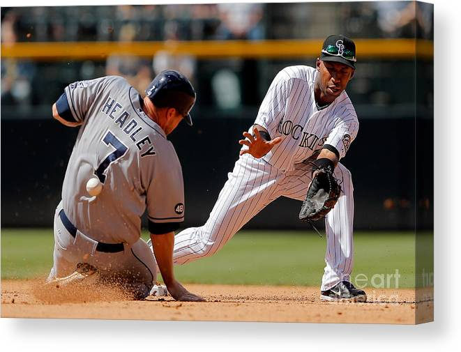 Sports Ball Canvas Print featuring the photograph Chase Headley and Jonathan Herrera by Doug Pensinger