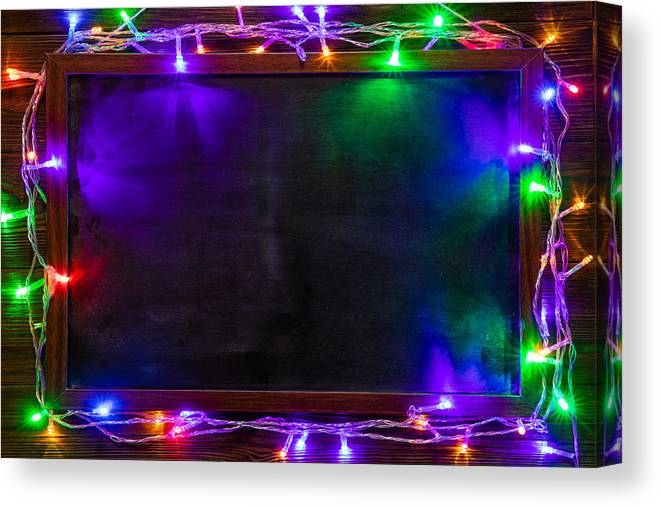 Event Canvas Print featuring the photograph Christmas background with Christmas decorations and garland. by Anton Petrus