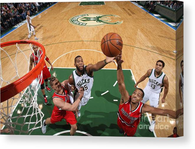Nba Pro Basketball Canvas Print featuring the photograph C.j. Mccollum and Greg Monroe by Gary Dineen